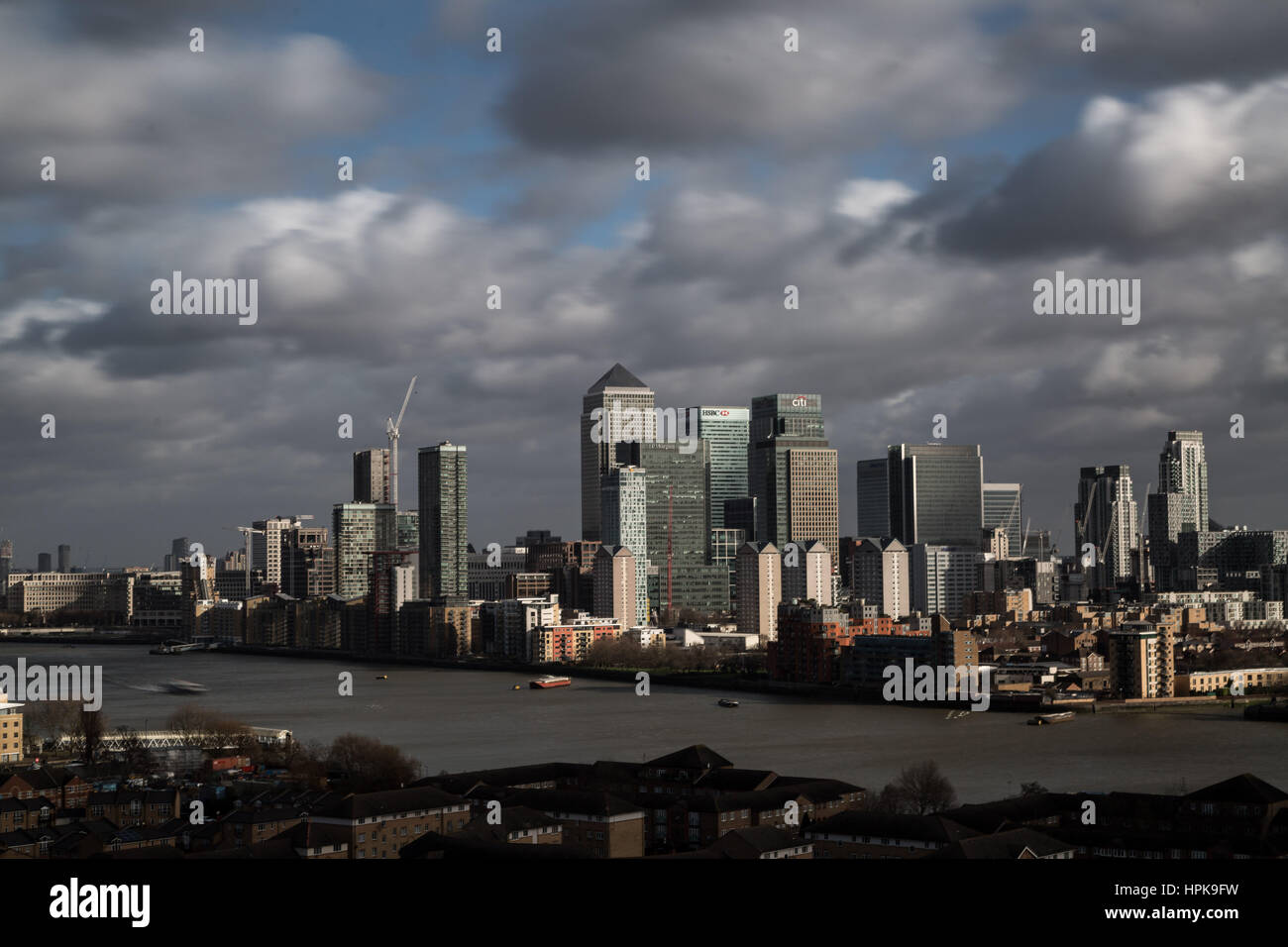 London, UK. 23rd February, 2017. UK Weather: Storm Doris brings fast moving clouds over Canary Wharf, London. Credit: Stock Photo