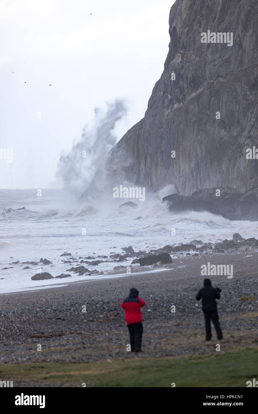 Storm chasers watching waves crash against the little orme, as Storm Doris smashes into North Wales and takes with - Stock Image