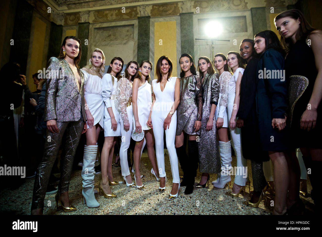 Milan, Italy. 23rd Feb, 2017. Designer Sara Cavazza (6th L) poses for a photo with her models backstage before the - Stock Image