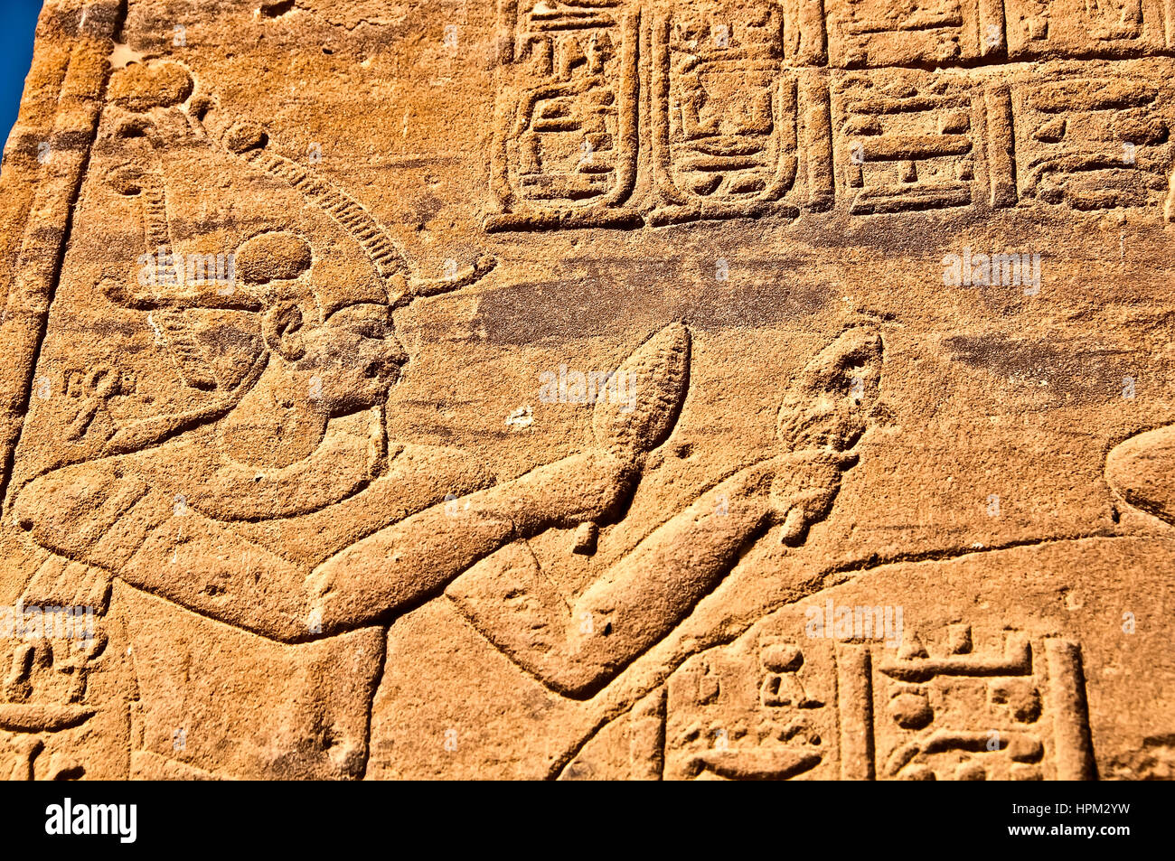 Pharaonic figure (possibly the god Osiris) at Philae Temple, or Temple of Isis at Philae Island - Stock Image