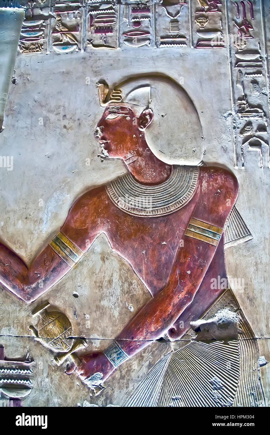Temple of Seti I at Abydos with remarkably preserved relief figure in bright red - Stock Image