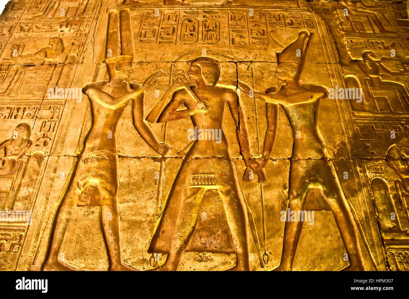 Temple of Seti I at Abydos illuminated wall with pharonic figures and numerous hieroglyphs - Stock Image