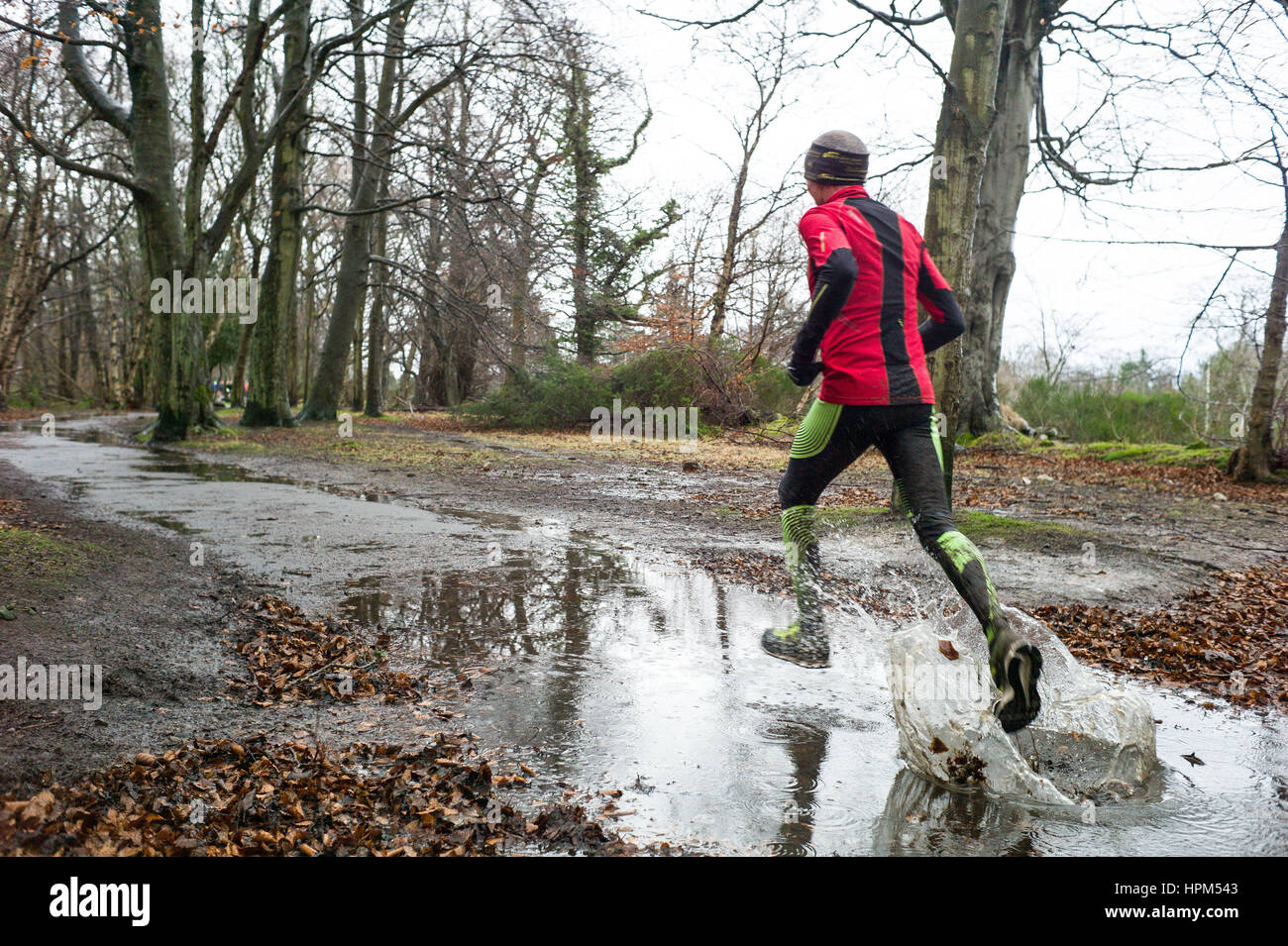 Runners take part  in the  Aberdeen weekly Park Run on a wet Saturday morning - Stock Image