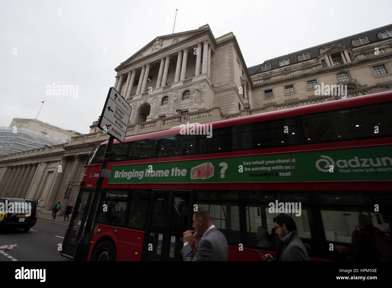 bank of england and wages, Bringing home the bacon Adzuna advert on side of bus outside bank of england - Stock Image