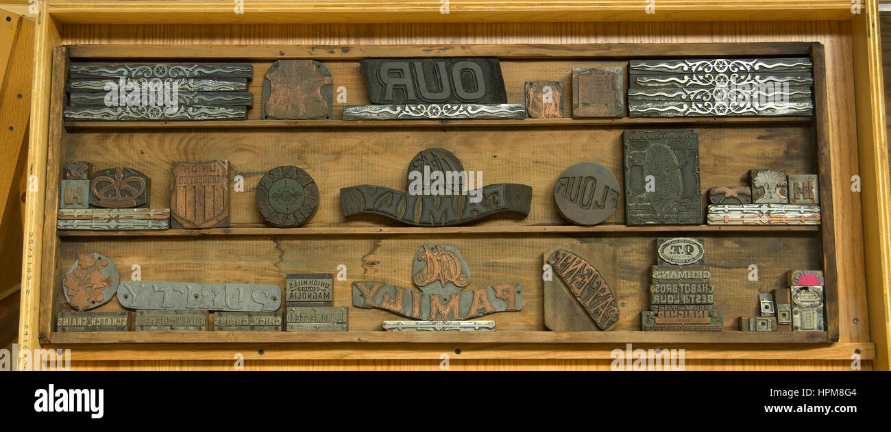 Antique metal printing blocks used for printed advertising, on display at Hamilton Wood Type and Printing Museum, - Stock Image
