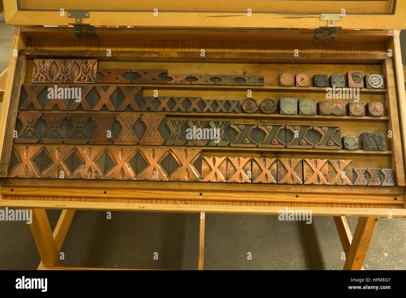 Antique metal and wood decorative printing blocks, on display at Hamilton Wood Type and Printing Museum, Two Rivers, - Stock Image