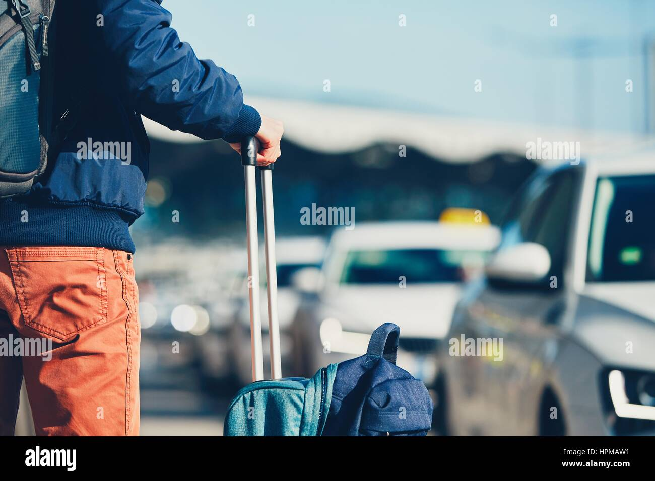 Airport taxi. Passenger is waiting for taxi car. - Stock Image