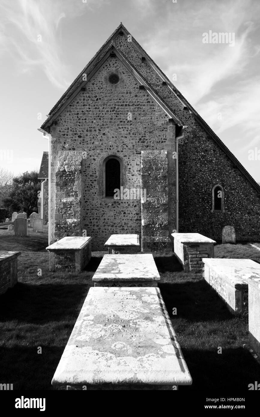 Black and white photograph of Bishopstone village church and grave yard, St Andrew's church , Bishopstone, united - Stock Image