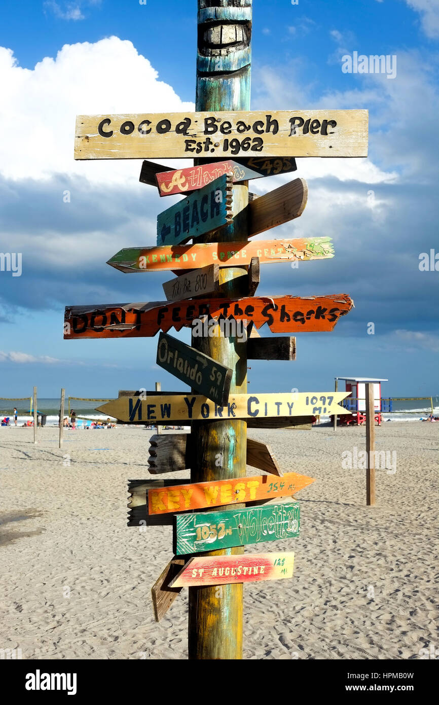 wooden sign on Cocoa beach, florida, USA, pointing to different places in USA with the distance to the places on - Stock Image