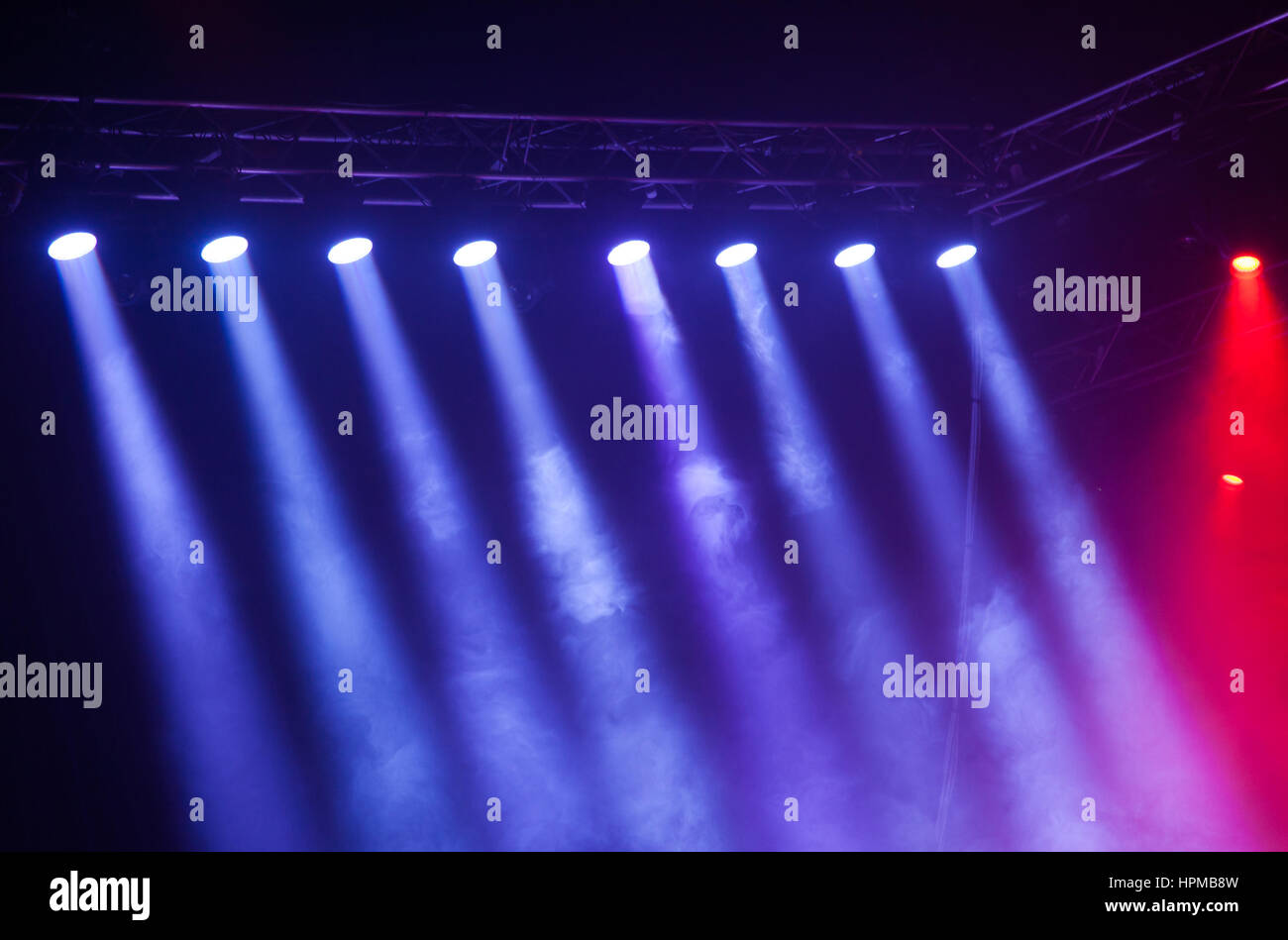 Stage lights on concert. Lighting equipment with multicolored beams. - Stock Image