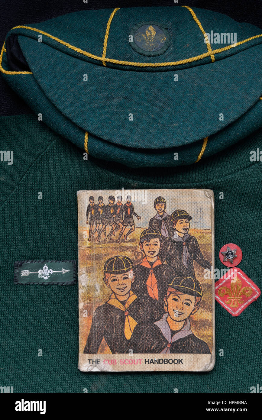UK Cub Scout handbook and uniform. Circa 1970's - Stock Image