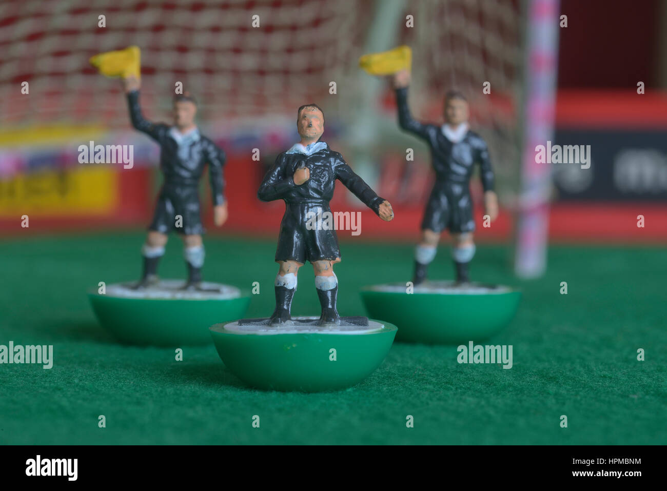Subbuteo table football referee and linesmen - Stock Image