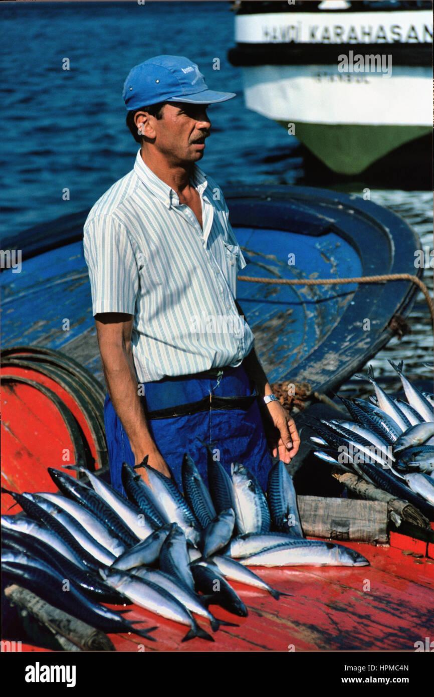 Fish Seller on the Quayside at Karakoy Istanbul Turkey - Stock Image