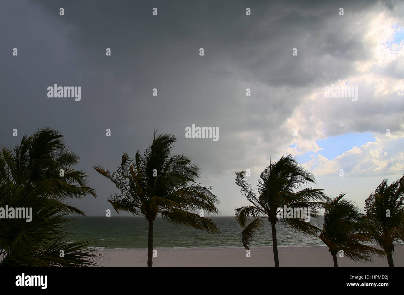 Thunderclouds above the Gulf of Mexico in Fort Myers Beach and the beach with a little bit of blue sky left. In Stock Photo