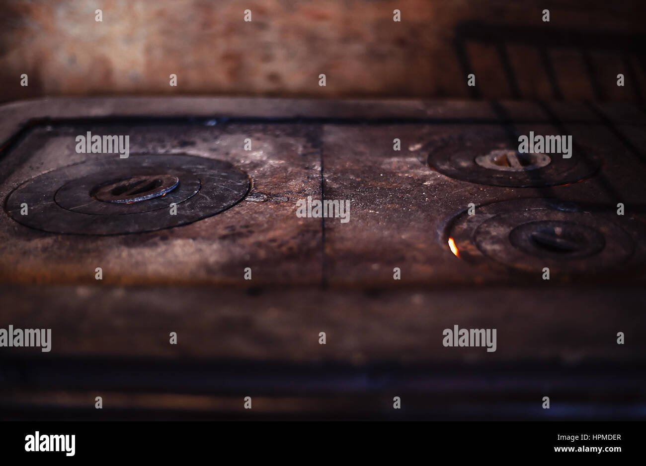 Closeup view of an old metal oven. - Stock Image