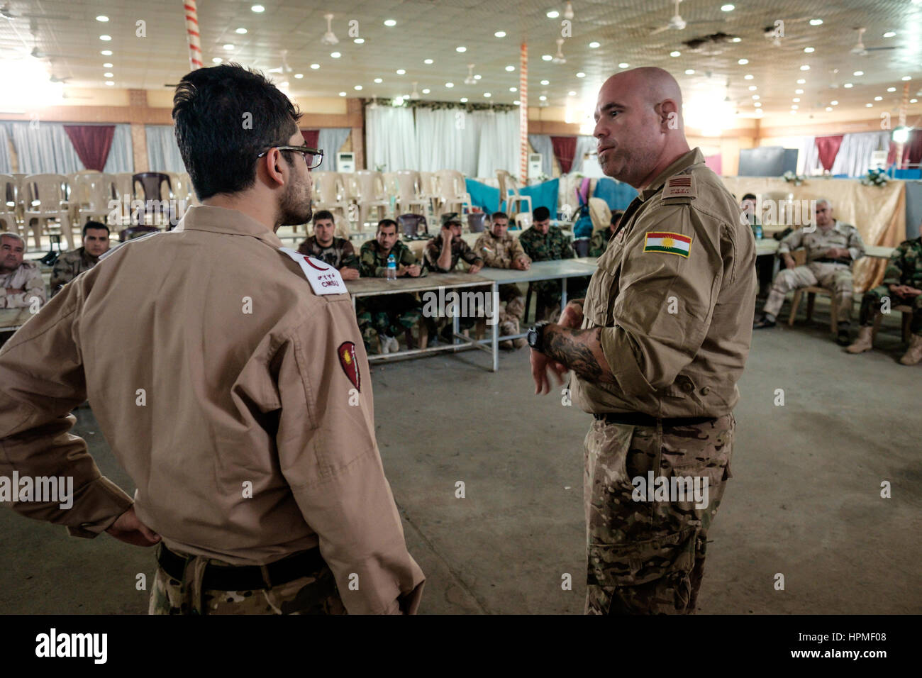 Unidentified Western Medical Volunteer help to train Kurdish forces at a field hospital in the front line town of Stock Photo
