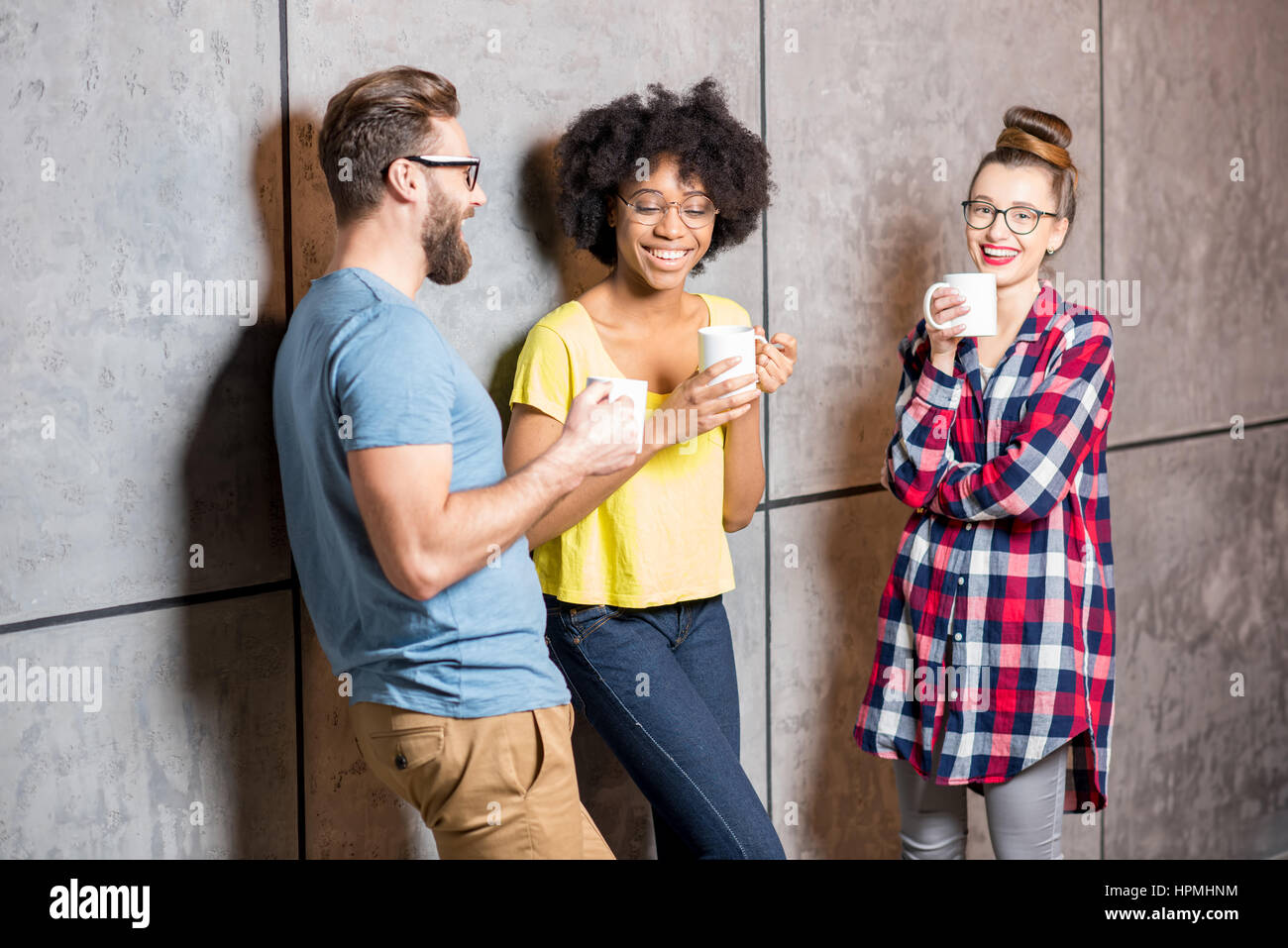Coworkers having a coffee break - Stock Image