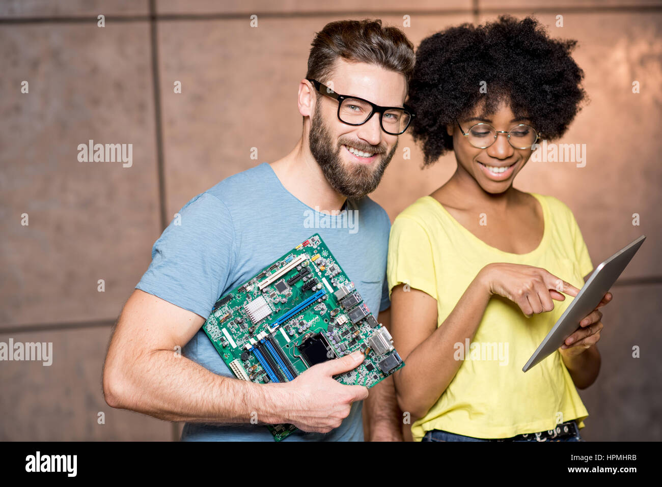 Programmers with computer motherboard - Stock Image