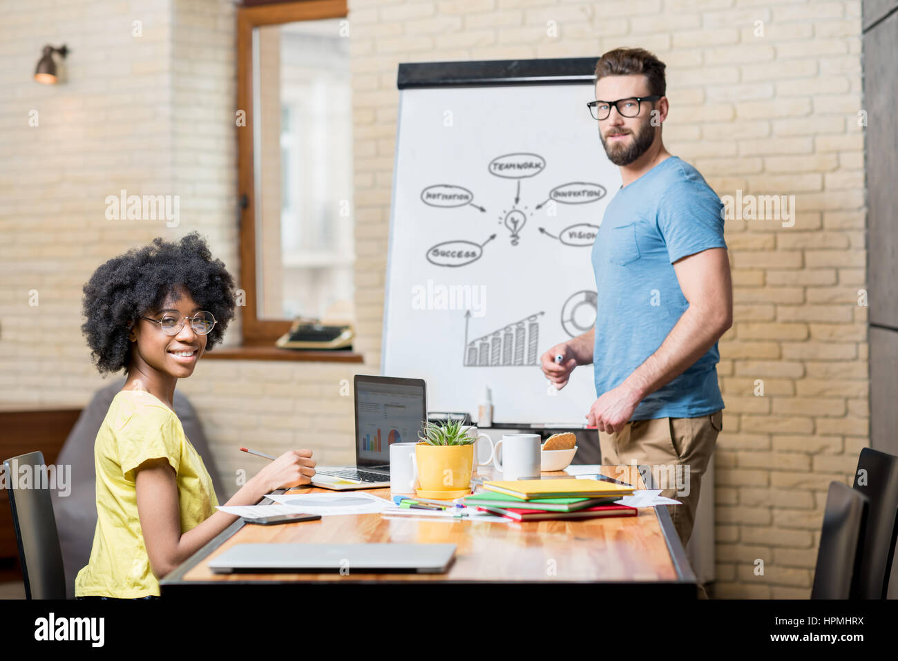 Coworkers working indoors - Stock Image