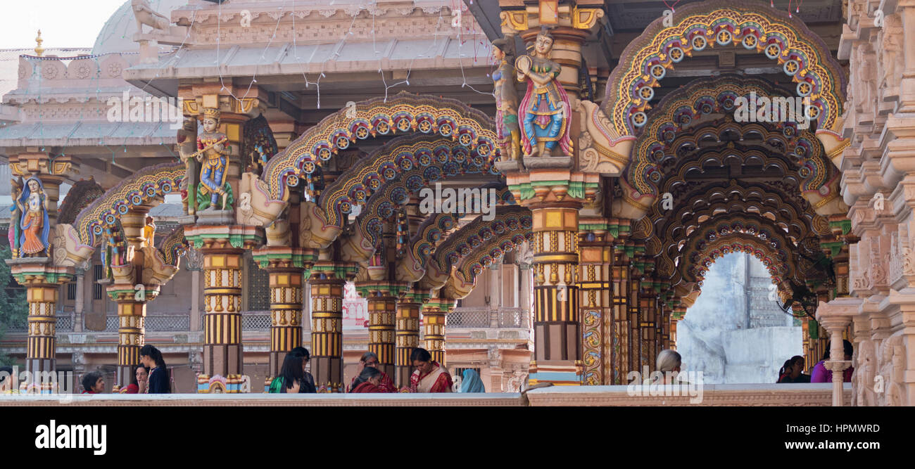 The brightly decorated Burmese teak archways in the Hindu Shri Swaminarayan Temple in Ahmedabad, India - Stock Image