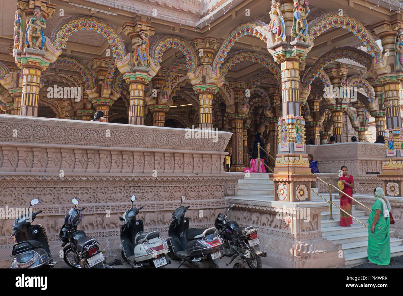 Transport belonging to Hindu devotees parked outside the colorful two hundred years old Shri Swaminarayan Hindu - Stock Image