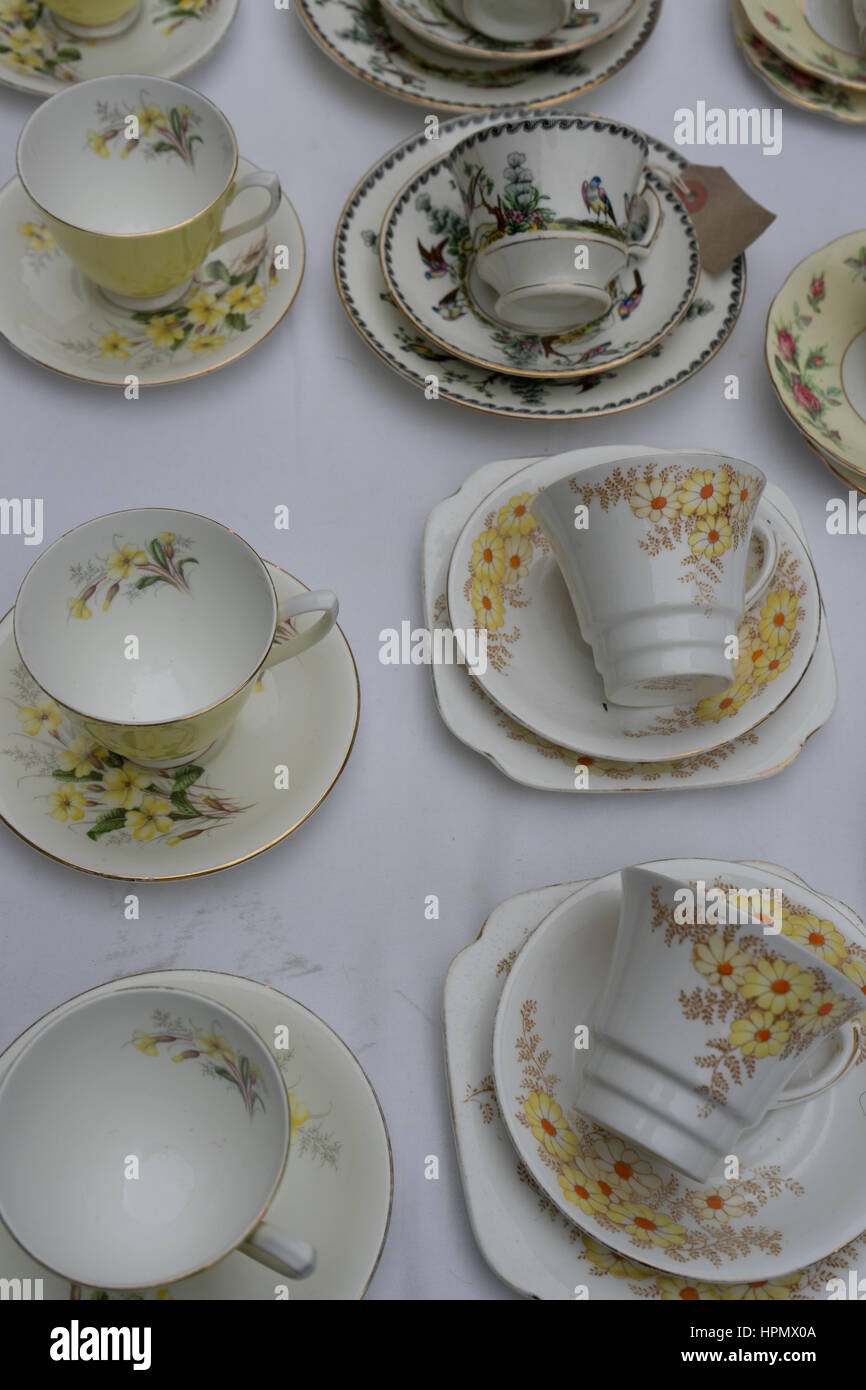 ornate china tea cups, saucers and plates - Stock Image