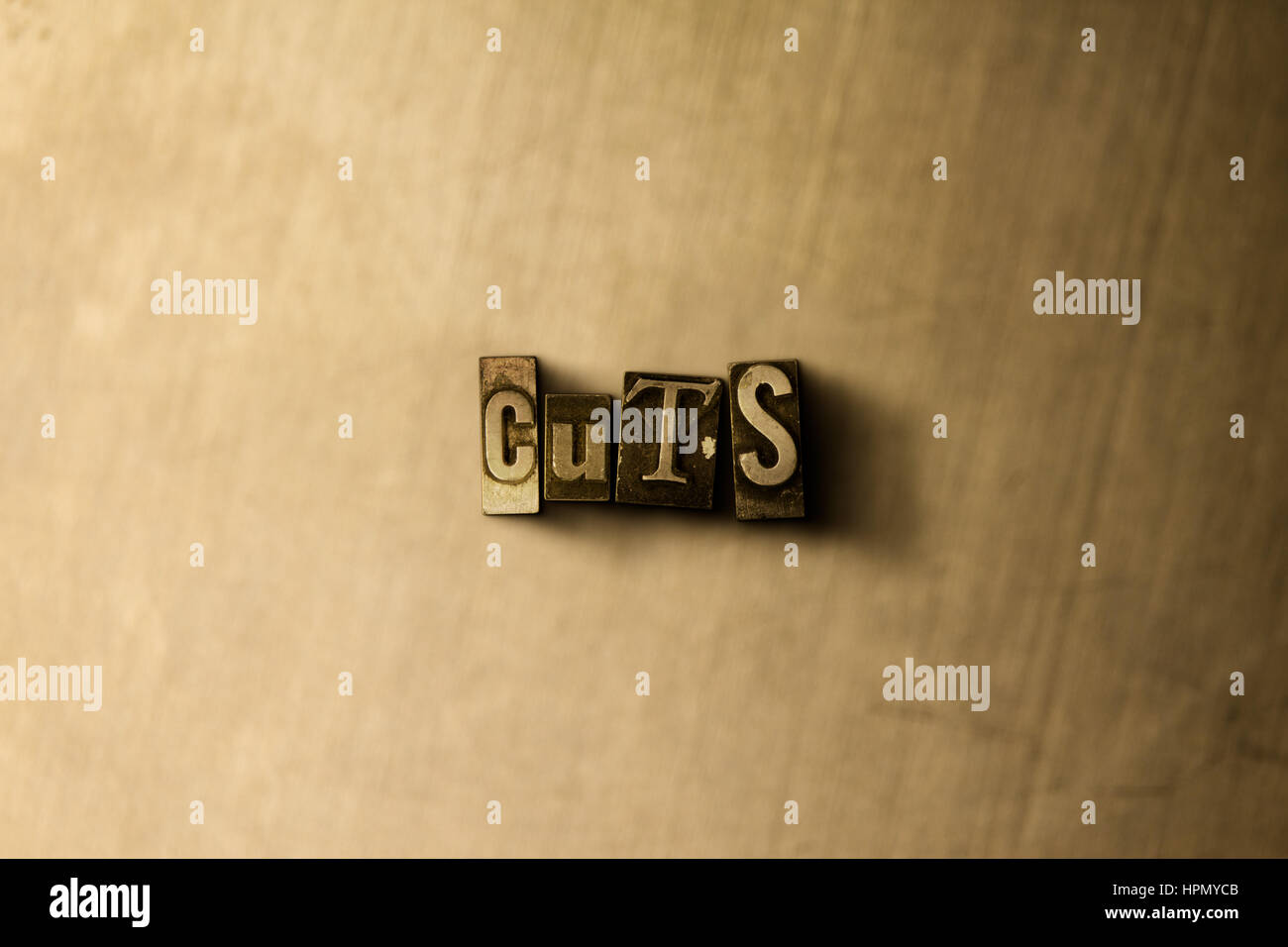 CUTS - close-up of grungy vintage typeset word on metal backdrop. Royalty free stock illustration.  Can be used - Stock Image