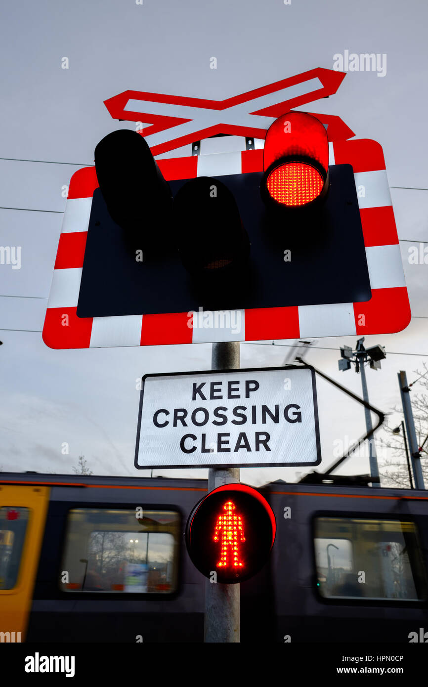 Pedestrian and road crossing over the Tyne and Wear metro at Kingston Park, Newcastle. - Stock Image