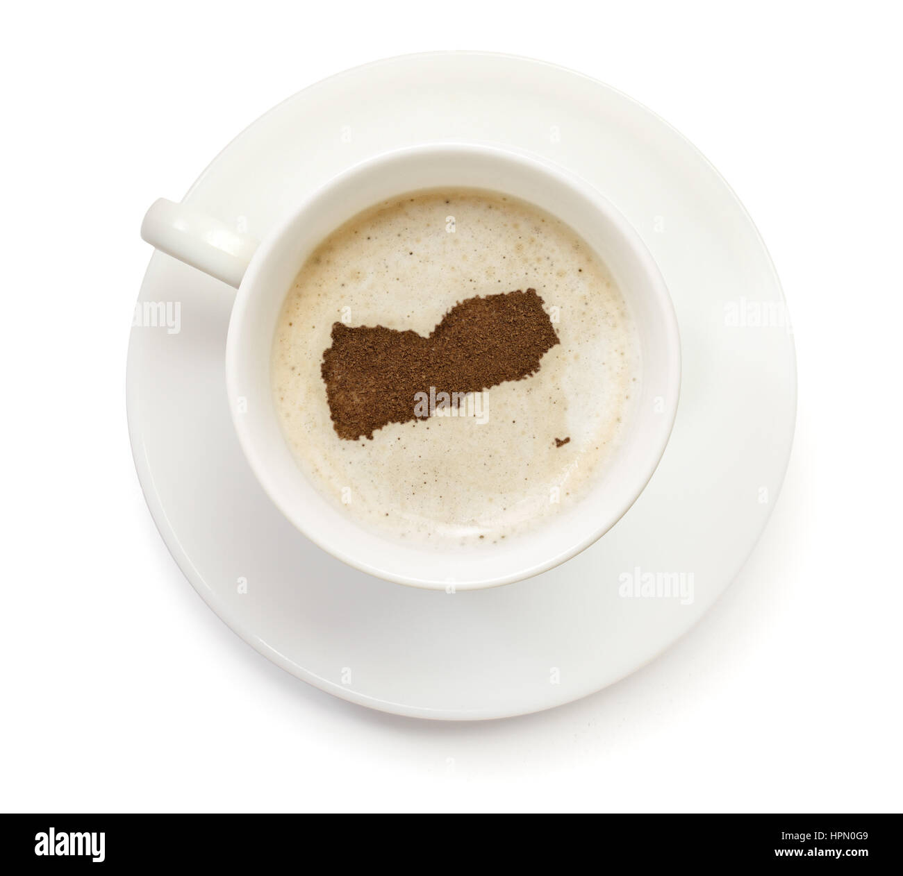 A cup of coffee with foam and powder in the shape of Yemen.(series) - Stock Image