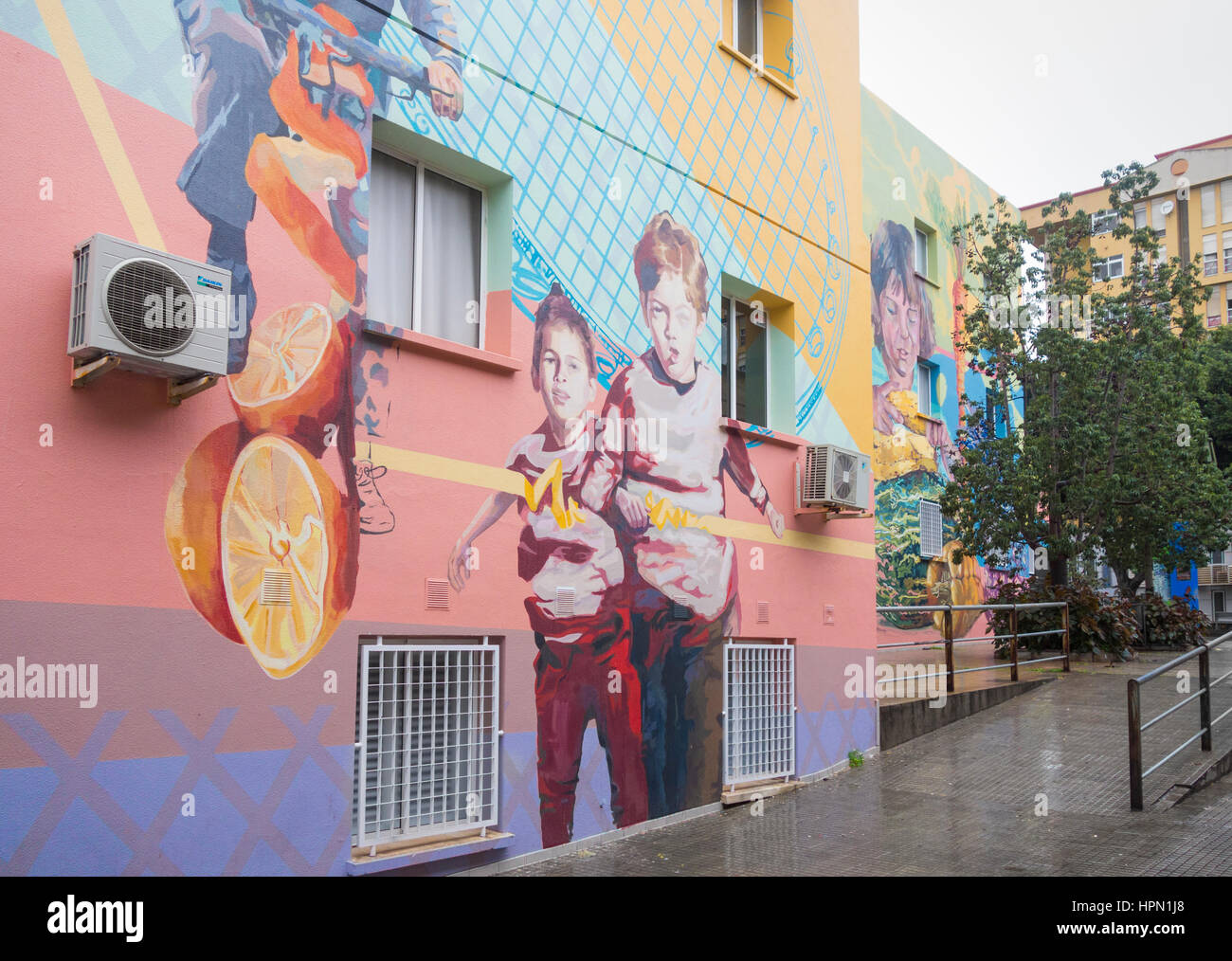 Health centre painted with large health promoting murals to encourage exercise and a healthy diet. Santa Cruz de Stock Photo