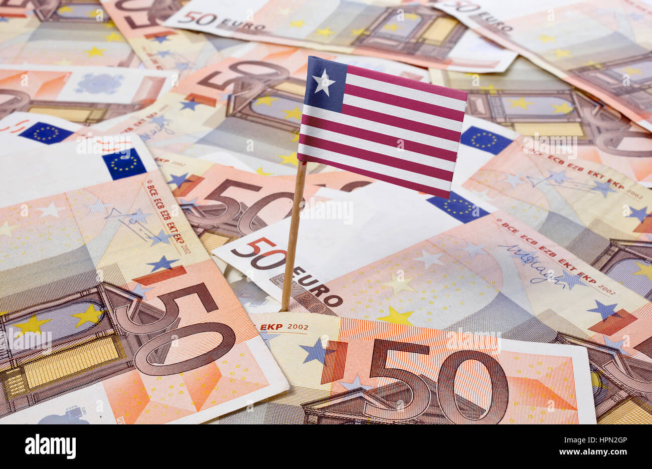 Flag of Liberia sticking in european banknotes.(series) - Stock Image