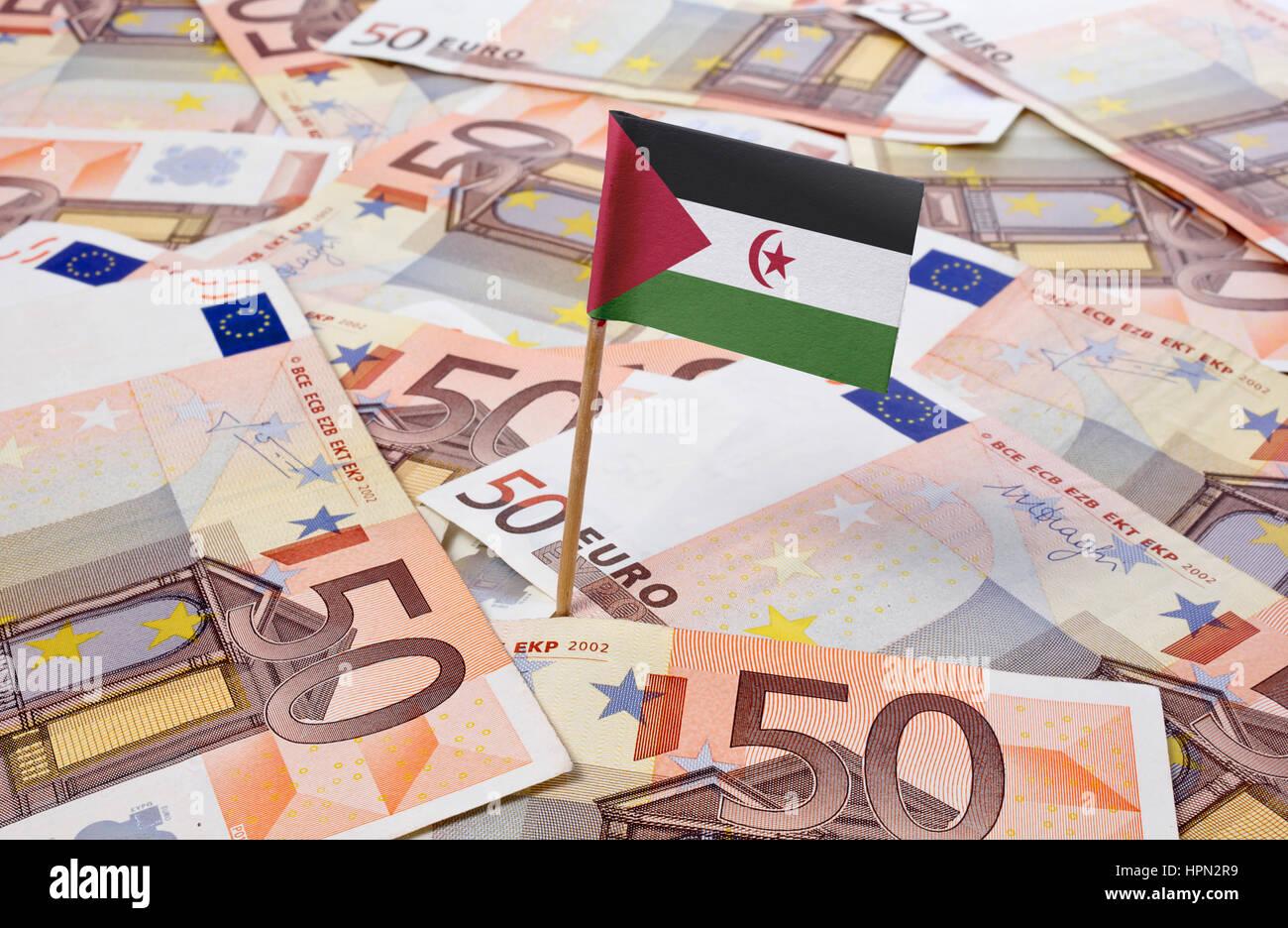 Flag of Western Sahara sticking in european banknotes.(series) - Stock Image