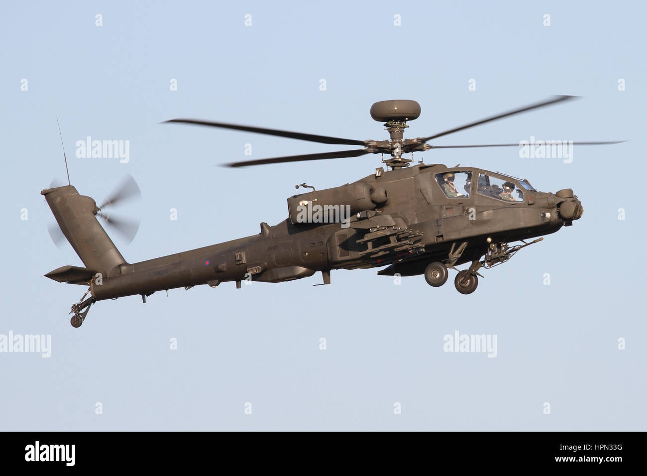 Army Air Corps Apache on the approach for runway 23 at Wattisham in the early evening sunlight. - Stock Image