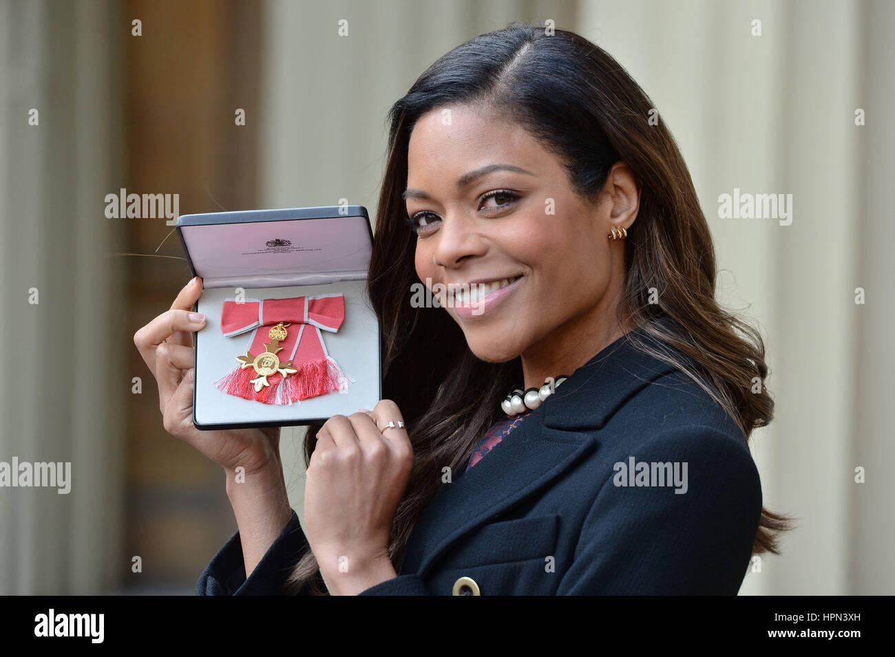 James Bond star Naomie Harris at Buckingham Palace, London, after receiving her OBE medal from Queen Elizabeth II. - Stock Image