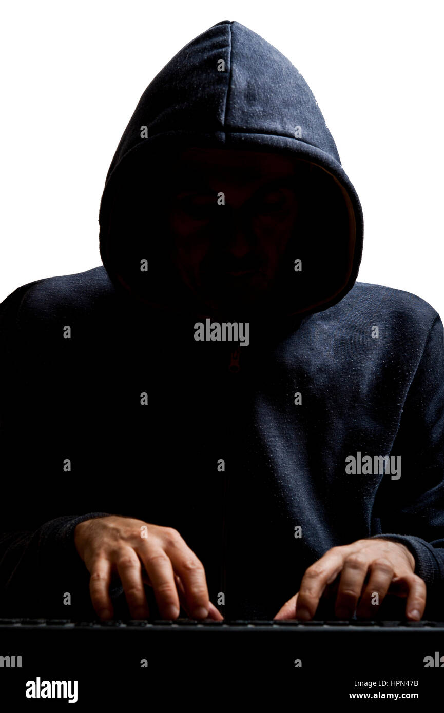 mysterious and anonymous hacker in action - Stock Image