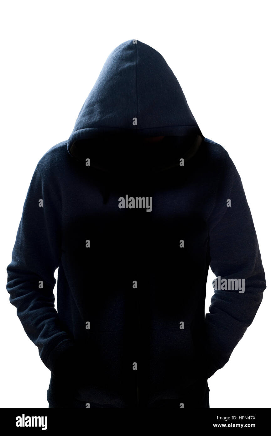 anonymous hooded man standing - Stock Image