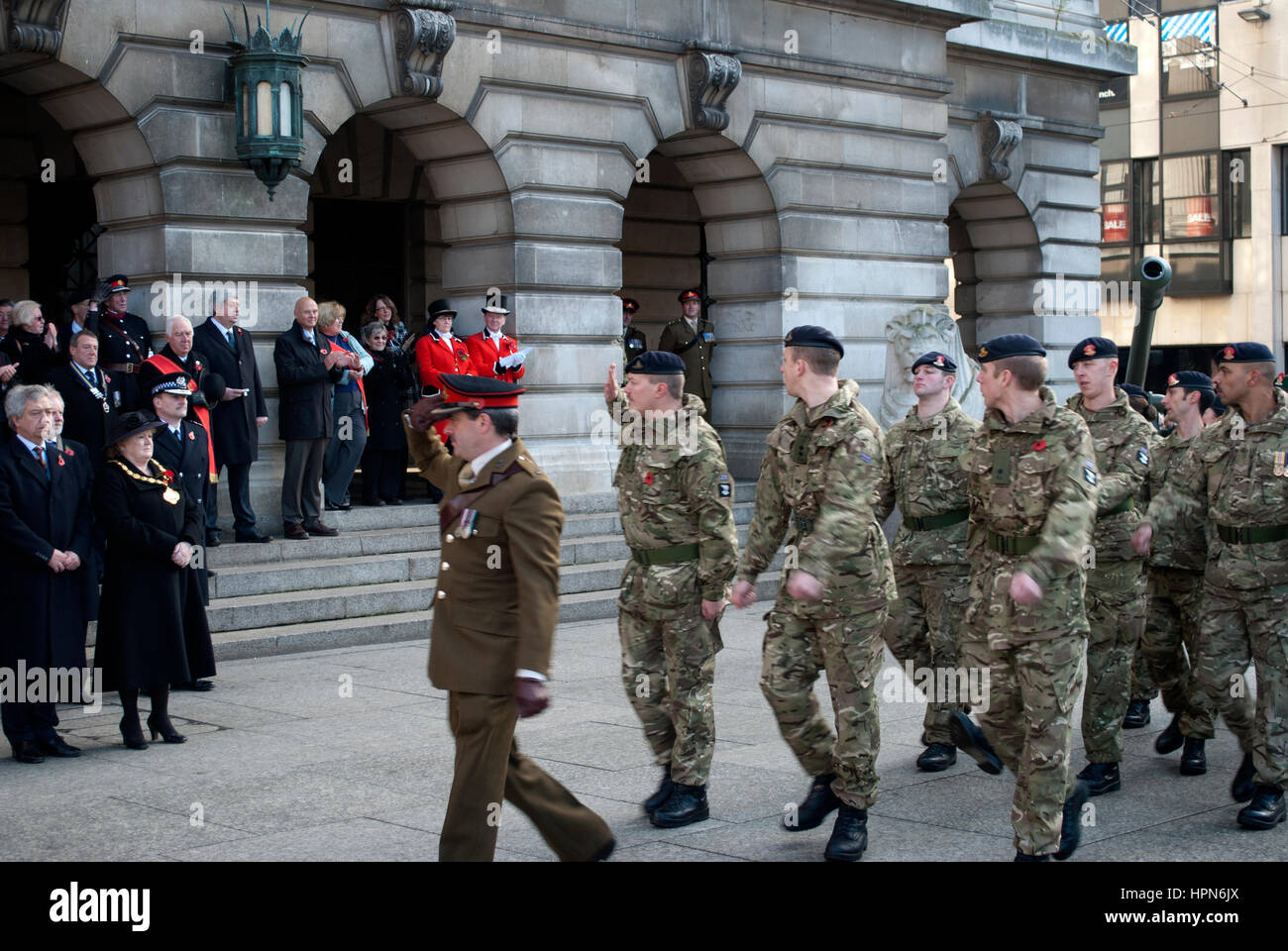 Soldiers marching past and saluting the mayor and other dignitaries outside the Nottingham Council House during - Stock Image