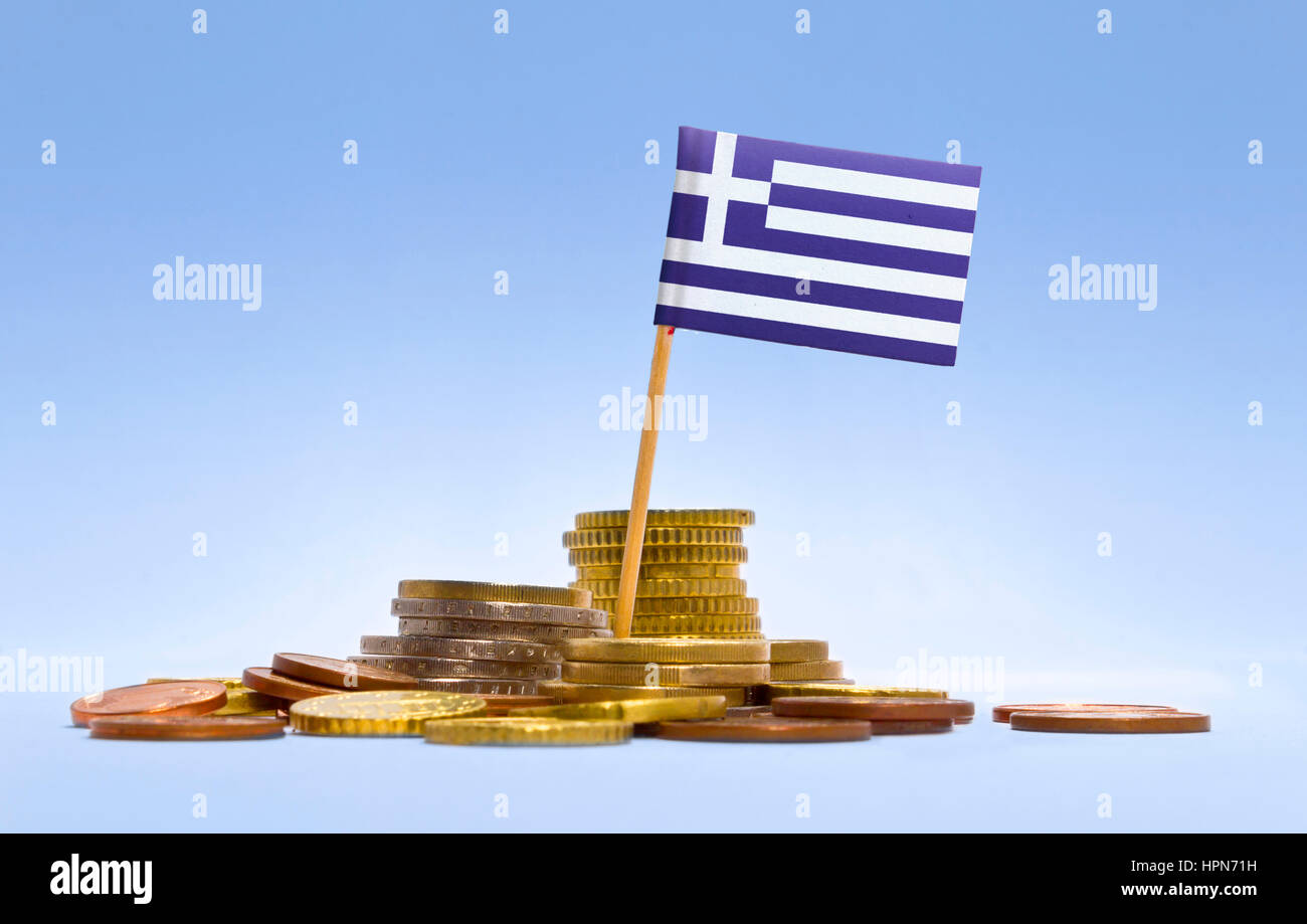 Flag of Greece in a mixed stack of european coins and a blue background.(series) - Stock Image