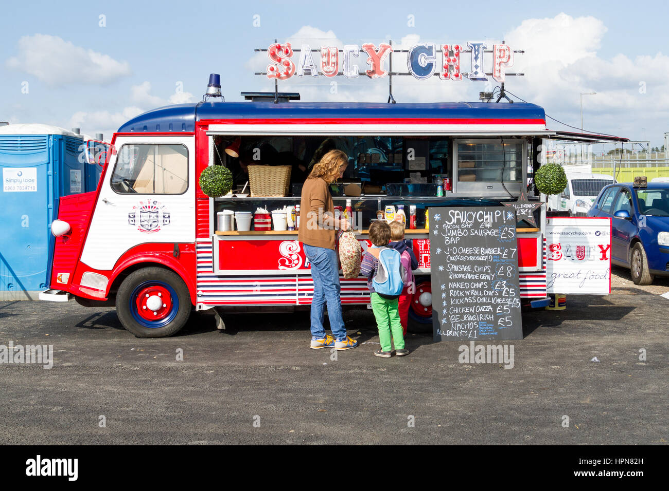 A colourful street food vendor van the Saucy chip at the classic car ...