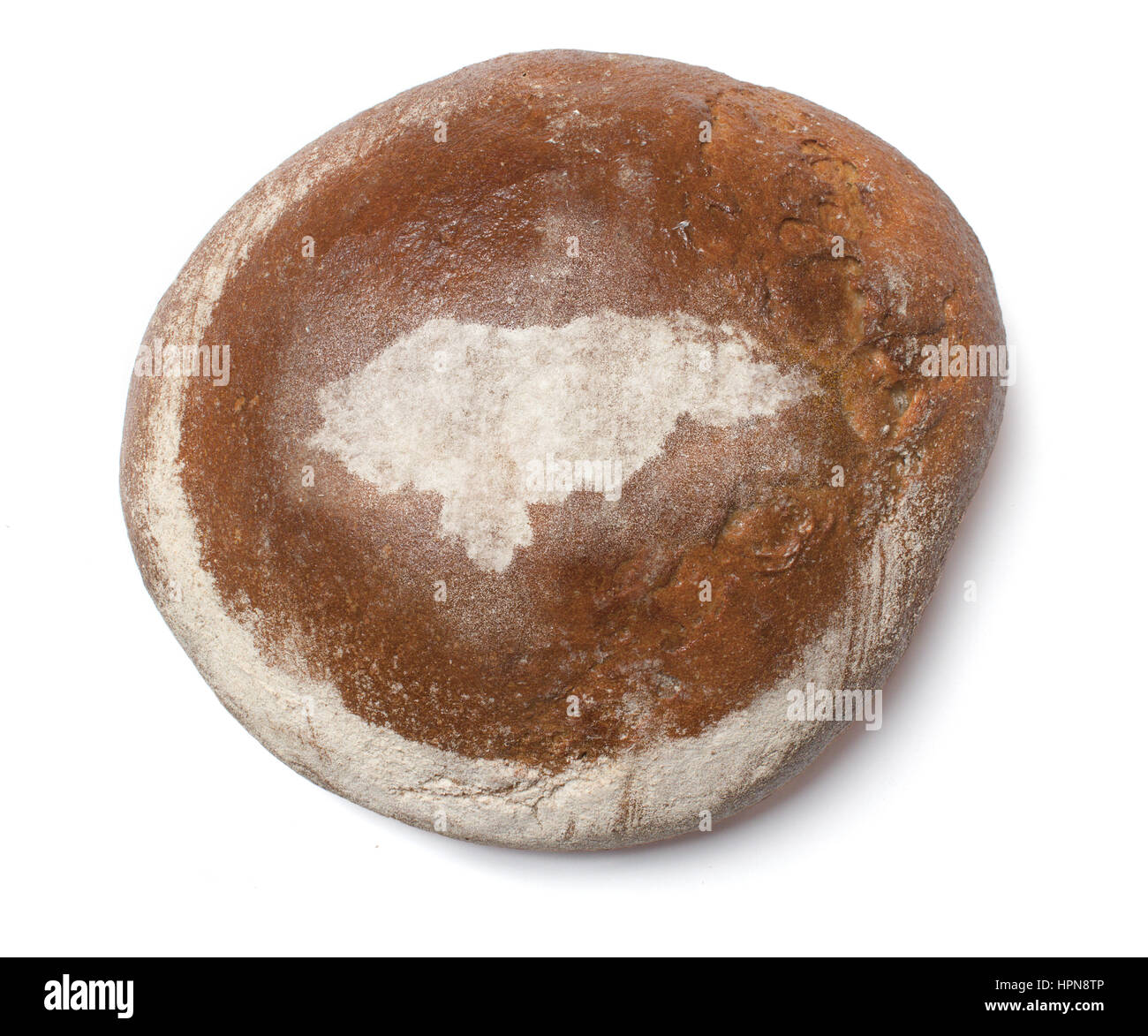 A freshly baked loaf of bread covered with rye flour in the shape of Honduras.(series) Stock Photo