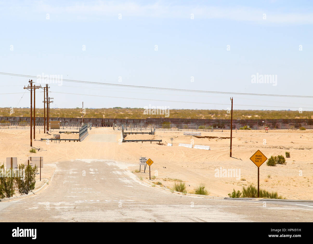 Winterhaven, California, USA - May 26, 2015: Dead end road at the fence at the U.S.-Mexico border. - Stock Image