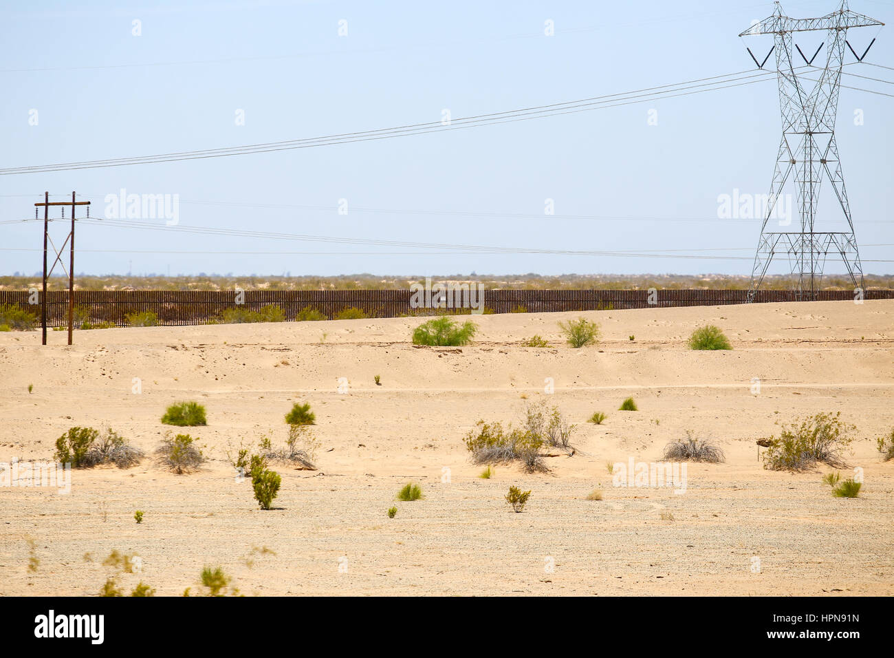 Winterhaven, California, USA - May 26, 2015: Fence in the desert at the U.S.-Mexico border. - Stock Image