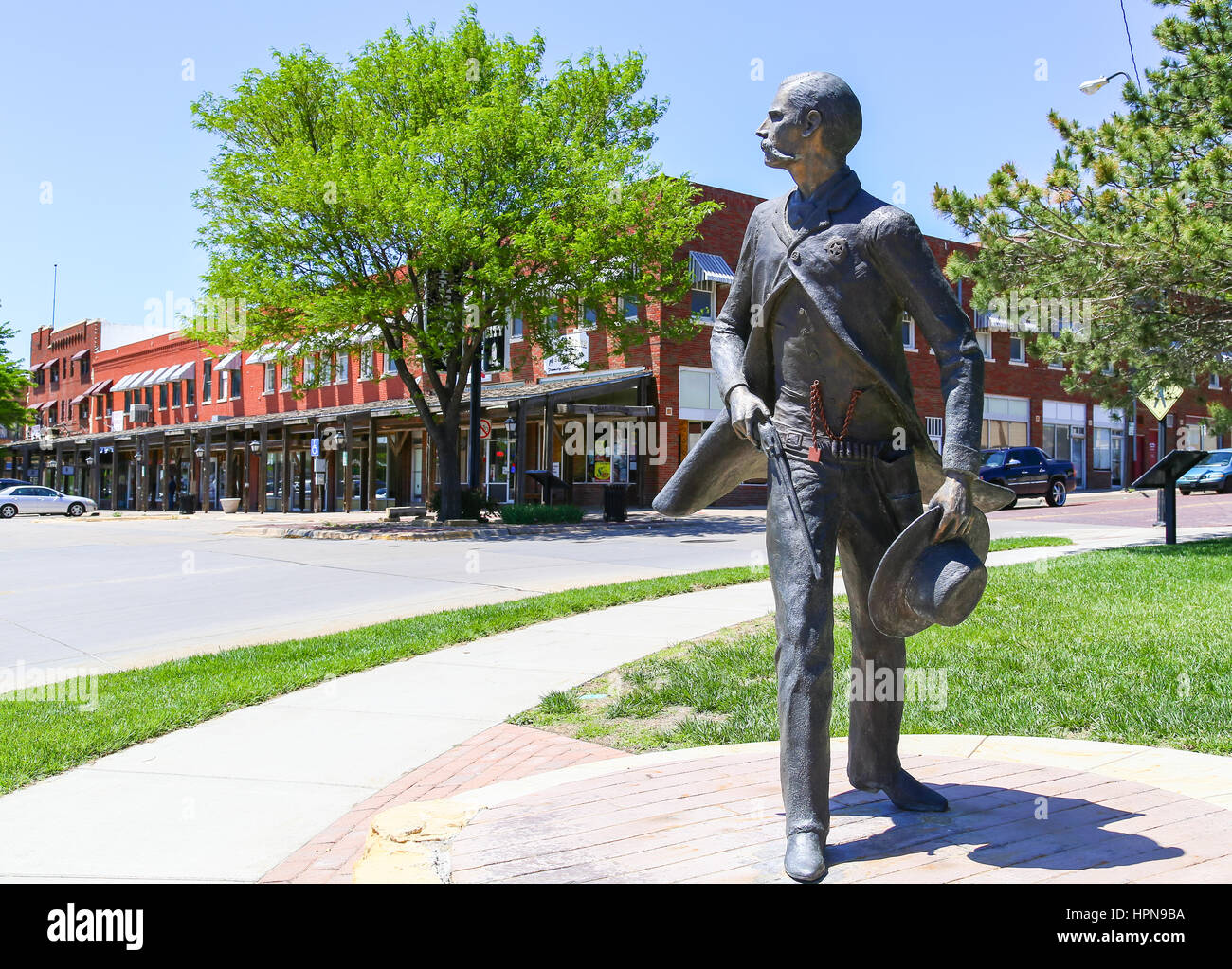 DODGE CITY, USA - MAY 17, 2015: Bronze sculpture of Wyatt Earp as part of the Trail of Fame in the historic district - Stock Image