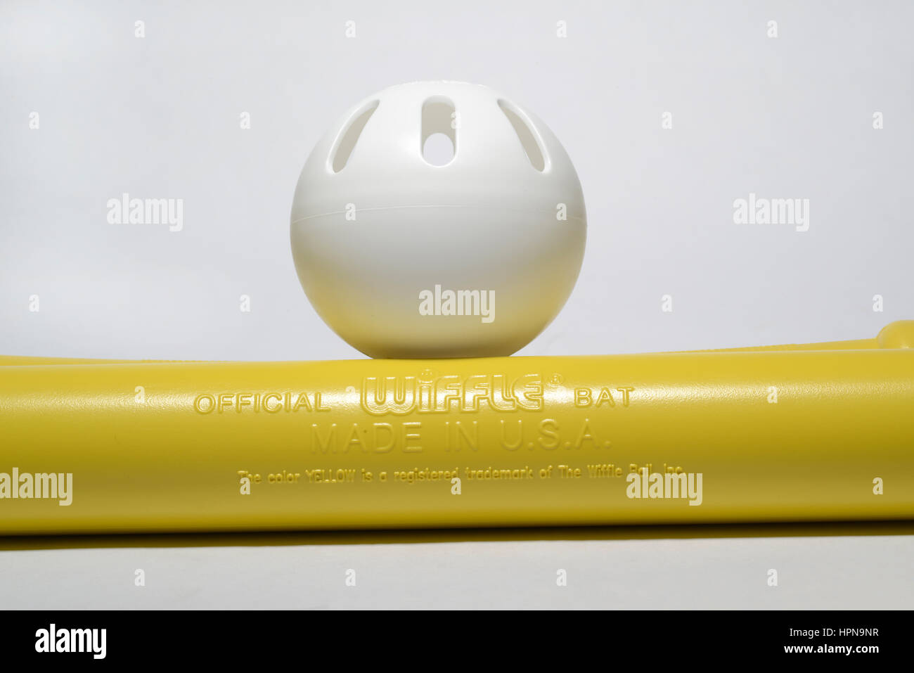 Wiffle ball and bats.  Made by The Wiffle Ball Inc.  Invented by the Mullany family of Connecticut.  They have registered - Stock Image