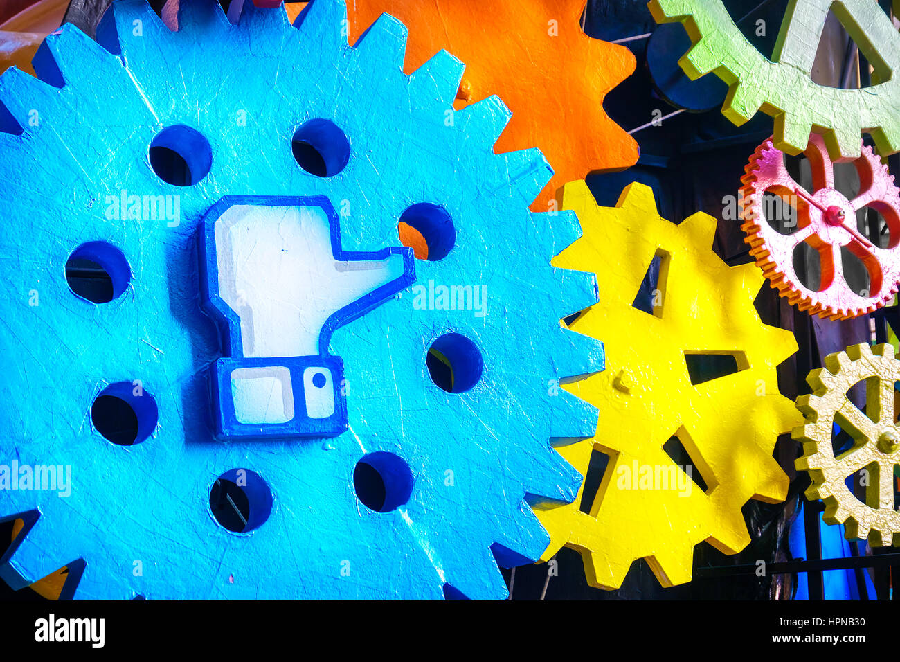 Facebook like symbol big gear - Stock Image