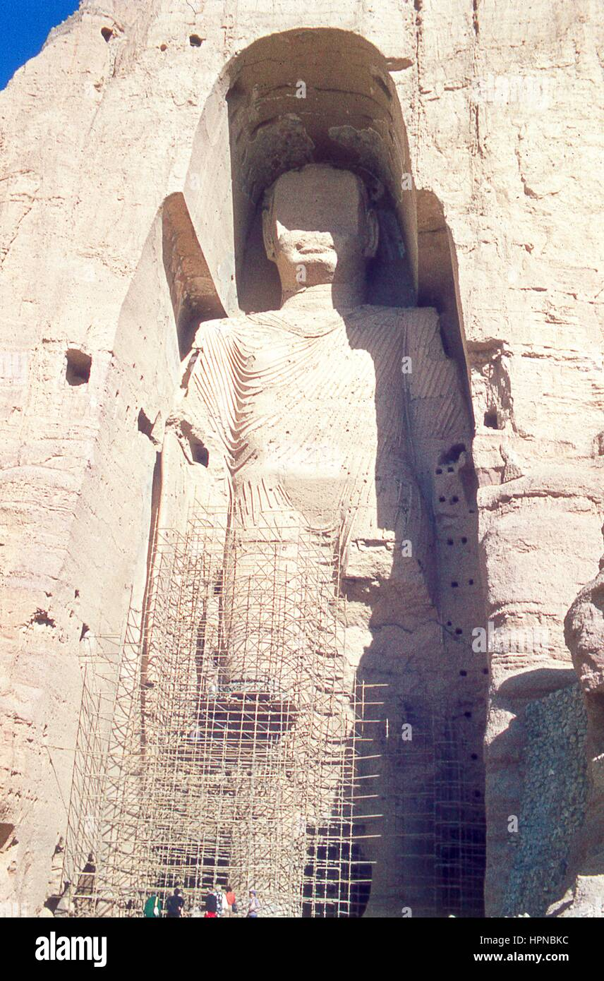 View of the taller Bamiyan Buddha statue, known as Salsal, standing in his giant niche, November, 1975. A group - Stock Image
