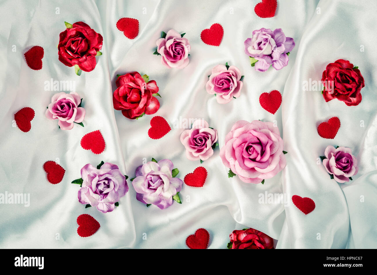 Many Of Roses And Red Heart On Elegant White Fabric Background Stock