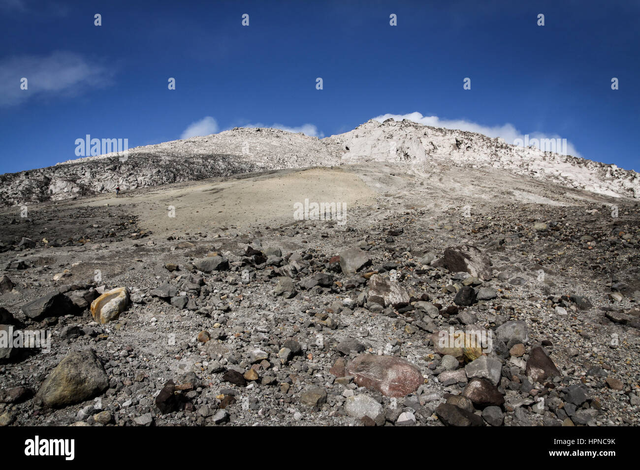 Looking up towards the Mount Merapi volcanic crater edge from Pasar Bubrah at the start of the final ascent. - Stock Image