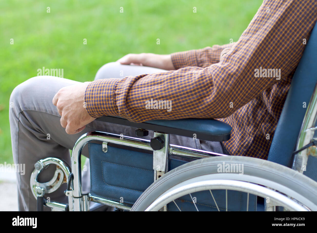Picture of a handicap businessman with his wheelchair - Stock Image