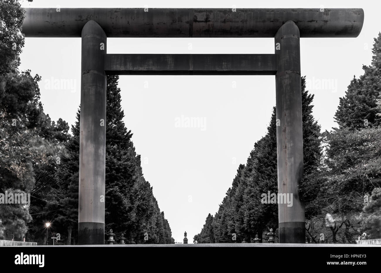 A large arch in Chiyoda that leads towards the controversial Yasukuni Shrine. Taken in black and white. - Stock Image